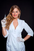 Portrait of sexy young nurse with a syringe — Stock Photo