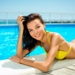 Beautiful young smiling woman in bikini — Stock Photo