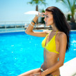 Beautiful young smiling woman with long hair in a bathing suit — Stock Photo