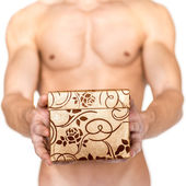 Young muscular man give a gift — Stock Photo