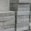 Pile of flat gray square pavement bricks — Stock Photo #23253320