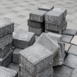 Stock Photo: Gray square pavement bricks in stockpile