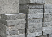 Pile of flat gray square pavement bricks — Stock Photo