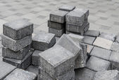 Gray square pavement bricks in a stockpile — Stock Photo