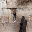 A poor man praying at the Wailing wall, Jerusalem, Israel. - Stock Photo