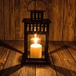 Black candlestick and candle naderevyanom table — Stockfoto