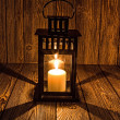 Black candlestick and candle naderevyanom table — Stock Photo