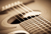 Grunge acoustic guitar — Stock Photo