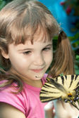 Girl with a butterfly on her hand — Stock Photo