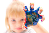 Little girl with hand in paint — Stok fotoğraf