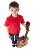 Wide angle shot of a little guitarist — Stock Photo