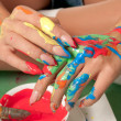 Hands of a girl colored with fresh paint — Stock Photo