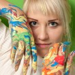 Portrait of a young girl with hands in fresh paint — Stock Photo