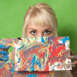 Attractive painter shows her abstract and impulsive painting — Stock Photo