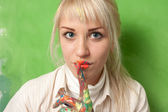 Woman with hands and lips covered with paint makes a hush and secret gesture — Stock Photo