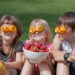 Three crazy little fruit lovers — Stock Photo
