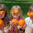 Three crazy little orange lovers — Stock Photo