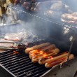 hotdogs and burgers on the grill — Stock Photo #27833695
