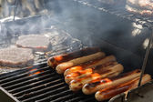 Grilling Hotdogs — Stock Photo