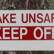 Stock Photo: Unsafe Lake Sign