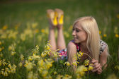 Girl in larkspur field — Stock Photo