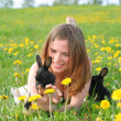 Girl with bunnies — Stock Photo #22979798