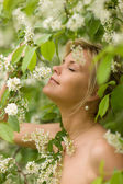 Girl with bird-cherry flowers — Stock Photo