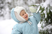 Kid with snowy branch — Stock Photo