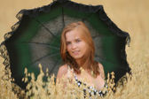 Girl with parasol — Stock Photo