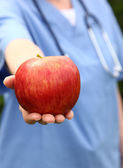 Doctor Holding Apple — Stock Photo