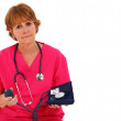 Nurse Holding Blood Pressure Monitor - Stock Photo