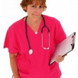 Nurse Looking Up Holding Clipboard — Stock Photo