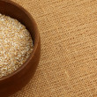 Bowl Of Steel Cut Oatmeal On Burlap Bag — Stock Photo #25225037