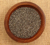 Close Up Of Chia Seeds In Wooden Bowl — Stock Photo