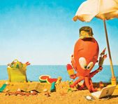 Cartoon clay octopus at the beach on summer holidays — Stock Photo