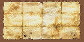 Brown aged damaged scratched paper background texture — Stock fotografie