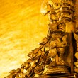 Golden Buddhist carving, Myanmar - Stock Photo