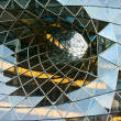 Faceted glass diminishing architectural funnel — Stock Photo