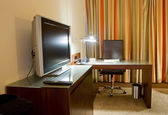 Study room with writing desk and tv set — Stock Photo