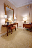 Room with vanity table and mirror — Stock Photo