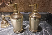 Two brass vessels with liquid soap — Stock Photo