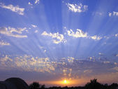 Cloudscape sunset with radial sunrays — Stock Photo