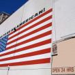 US flag with slogan proud to be american — Stock Photo