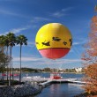Multicolored balloon moored to landing stage — Stock Photo #23879047