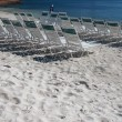 Empty sunloungers rows at sand beach  — Stock Photo