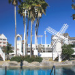 Recreational resort poolside with white windmill — Foto de Stock