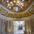 Luxury classic colonnade corridor and ornate luster - Stock Photo