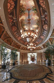 Luxury classic colonnade corridor with ornate luster — Stock Photo