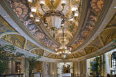 Hall with ceiling drawings and two decorative chandeliers — Стоковое фото