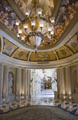 Luxury classic colonnade corridor and ornate luster — Стоковое фото